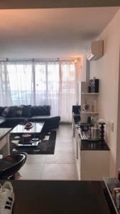 Departamento en venta en edificio YOO, 1 dormitorio y medio, 2 baños, living, comedor, cocina, terraza y garaje.
